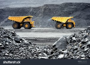 Dump trucks at work in producing useful minerals